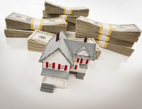 Stacks of Hundreds of Dollars with Small House Stock photo © feverpitch