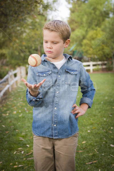 Handsome Young Boy Tossing Up Baseball in the Park Stock photo © feverpitch