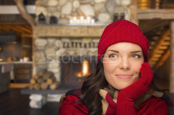 Mixed Race Girl Enjoying Warm Fireplace In Rustic Cabin Stock photo © feverpitch