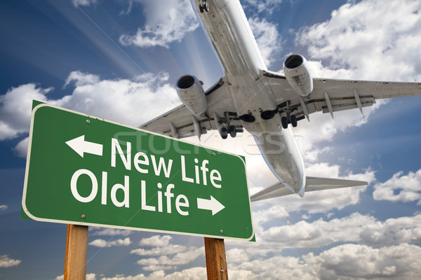 New Life, Old Life Green Road Sign and Airplane Above Stock photo © feverpitch