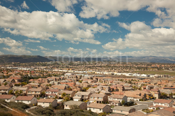 Contemporary Neighborhood and Majestic Clouds Stock photo © feverpitch