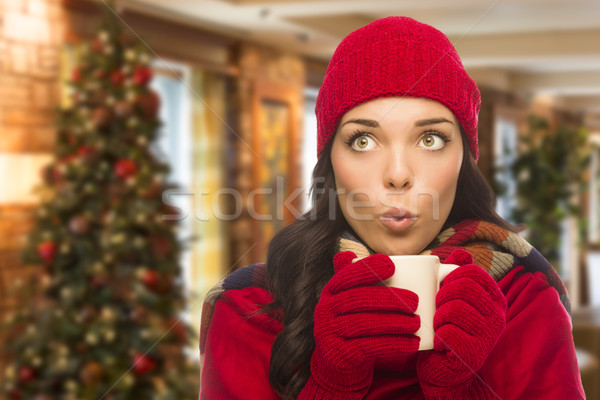 Mixed Race Woman Wearing Hat and Gloves In Christmas Setting Stock photo © feverpitch