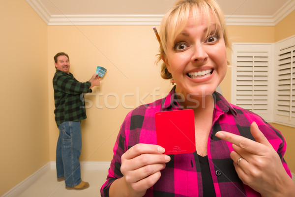 Couple Comparing Paint Colors in Empty Room Stock photo © feverpitch