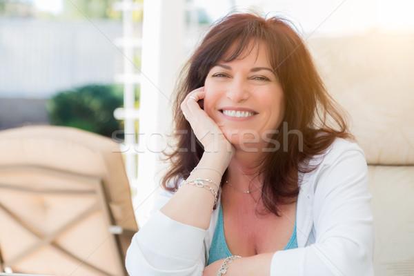 Vonzó középkorú nő portré mosoly belső udvar lány Stock fotó © feverpitch