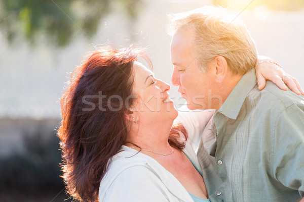 Middle Aged Couple Enjoy A Romantic Slow Dance Outside Stock photo © feverpitch