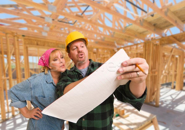 Contractor Showing Plans to Woman On Site Inside New Home Constr Stock photo © feverpitch