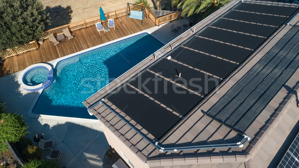 Thermal Solar Panels Installed on the Roof of a Large House Stock photo © feverpitch