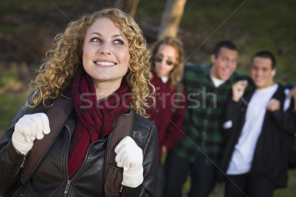 Pretty Young Teen Girl with Boys Behind Admiring Her Stock photo © feverpitch