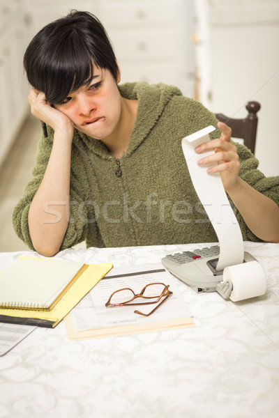 Multi-ethnic Young Woman Agonizing Over Financial Calculations Stock photo © feverpitch