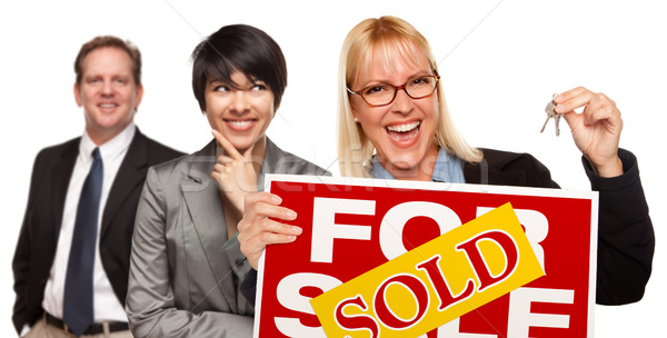 Real Estate Team with Woman Holding Keys and Sold For Sale Sign Stock photo © feverpitch