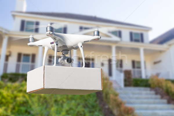 Unmanned Aircraft System (UAV) Quadcopter Drone Delivering Packa Stock photo © feverpitch