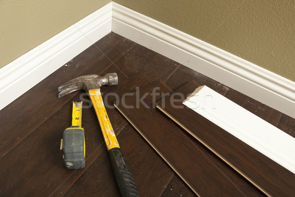 Stock photo: Hammer, Laminate Flooring and New Baseboard Molding
