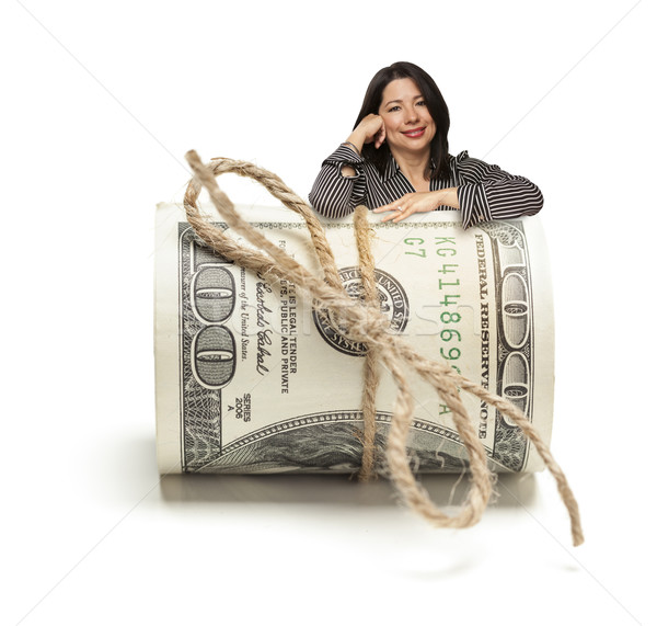 Hispanic Woman Leaning on a Roll Of Hundred Dollar Bills Stock photo © feverpitch