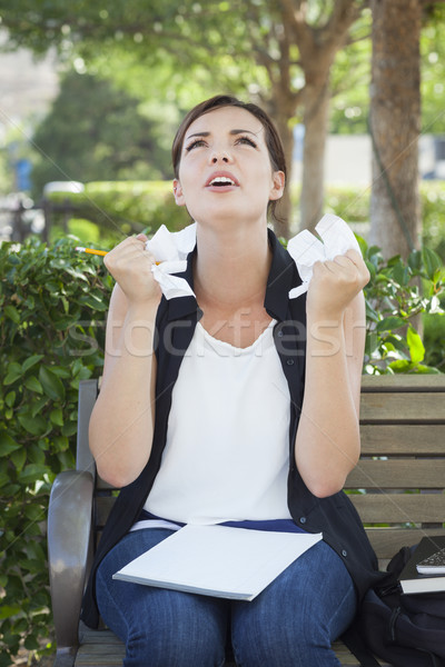 Stock photo: Upset Young Woman with Pencil and Crumpled Paper in Hands