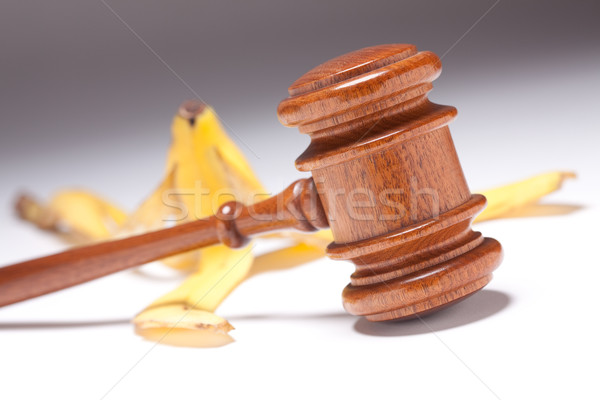 Gavel and Banana Peel on Gradated Background Stock photo © feverpitch