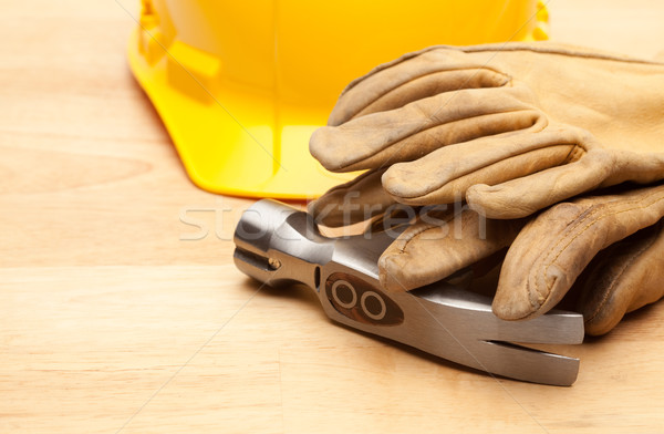 Yellow Hard Hat, Gloves and Hammer on Wood Stock photo © feverpitch