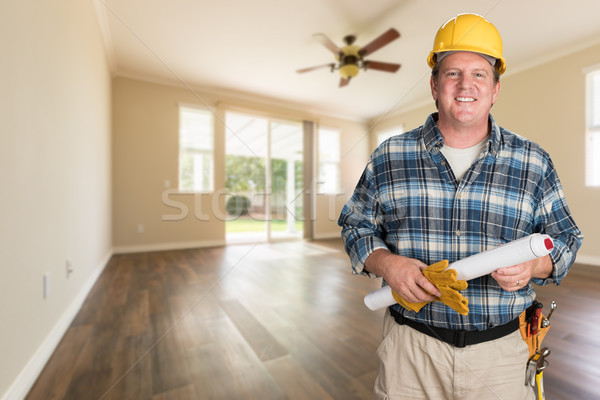 Contractor With Plans and Hard Hat Inside Empty Room with Wood F Stock photo © feverpitch