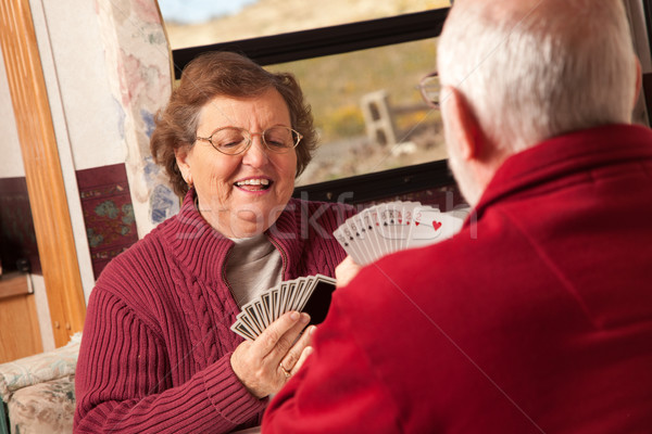 Happy Senior Adult Couple Playing Cards in Their Trailer RV Stock photo © feverpitch