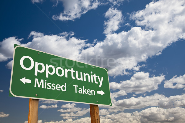 Opportunity Missed and Taken Green Road Sign and Clouds Stock photo © feverpitch