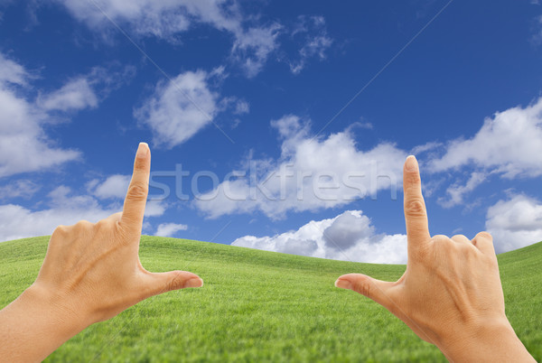 Kadın eller derin mavi gökyüzü üzerinde çim alanı Stok fotoğraf © feverpitch