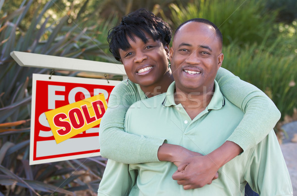 Happy Couple and Real Estate Sign Stock photo © feverpitch
