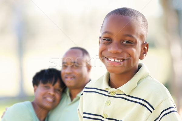 Handsome African American Boy with Parents Stock photo © feverpitch