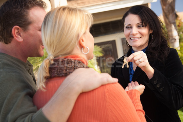 Stock photo: Attractive Hispanic Female Real Estate Agent Handing Over Keys