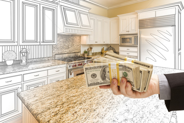 Hand Handing Cash Over Kitchen Design Drawing and Photo Combinat Stock photo © feverpitch