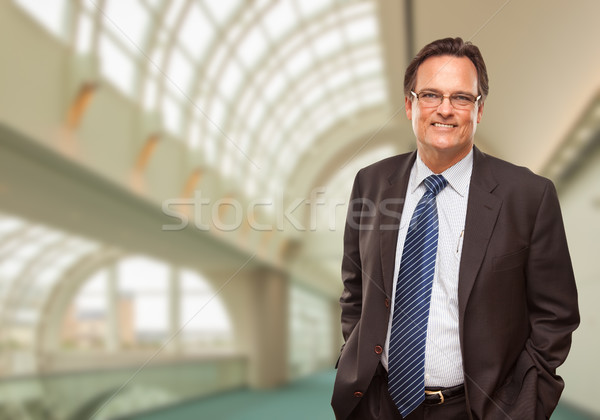 Happy Businessman Inside Corporate Building Stock photo © feverpitch