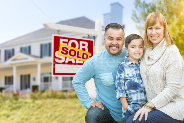 Stock photo: Mixed Race Family In Front of House and Sold For Sale Real Estat