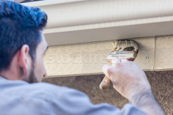Professional Painter Using Brush to Paint House Fascia Under Rai Stock photo © feverpitch