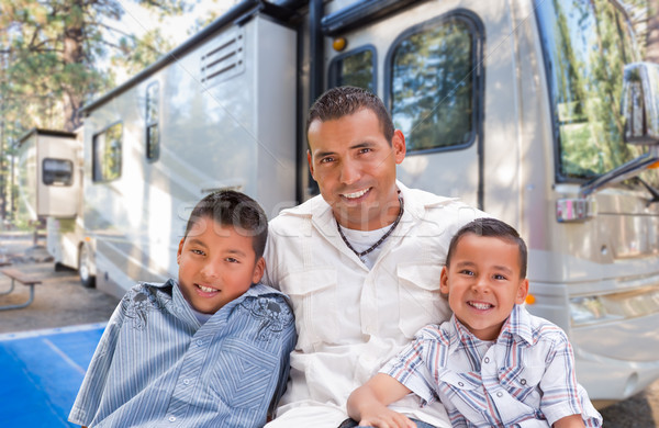 Happy Hispanic Father and Sons In Front of Their Beautiful RV At Stock photo © feverpitch