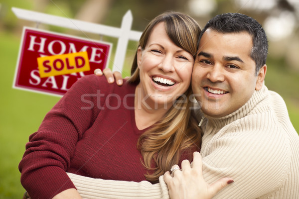 Mixed Race Couple in Front of Sold Real Estate Sign Stock photo © feverpitch