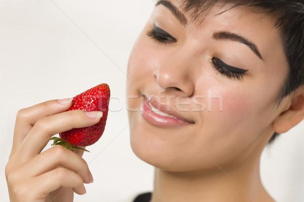 Pretty Hispanic Woman Holding Strawberry Stock photo © feverpitch