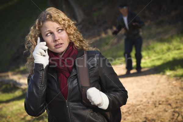 Pretty Young Teen Girl Walking with Man Lurking Behind Her Stock photo © feverpitch