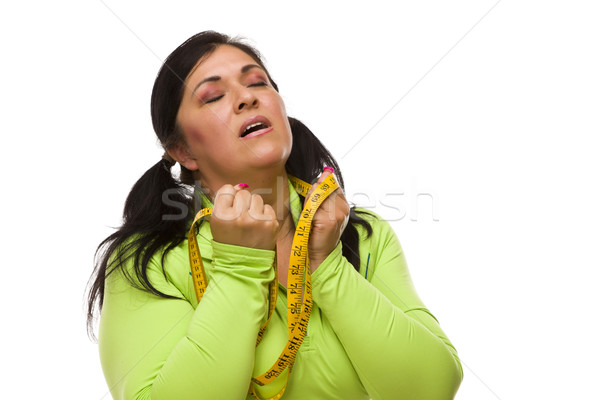 Frustrated Hispanic Woman with Tape Measure Stock photo © feverpitch