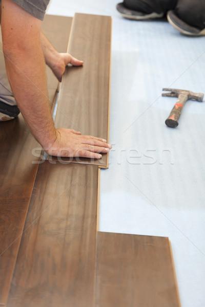 Férfi installál új fa parketta absztrakt Stock fotó © feverpitch