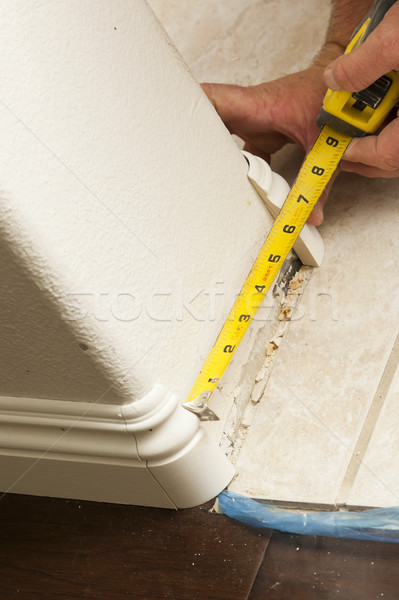 Stock photo: Measuring for New Baseboard with Bull Nose Corners and New Lamin