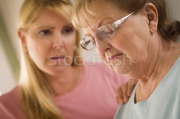 Young Woman Consoles Senior Adult Female Stock photo © feverpitch