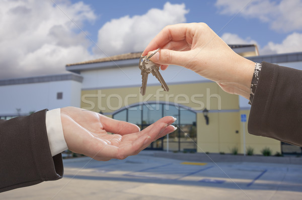 Agent Handing Over the Keys in Front of Business Office Stock photo © feverpitch
