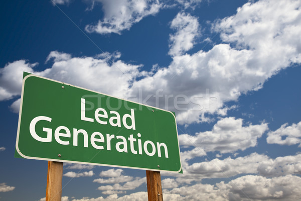 Stock photo: Lead Generation Green Road Sign Over Sky
