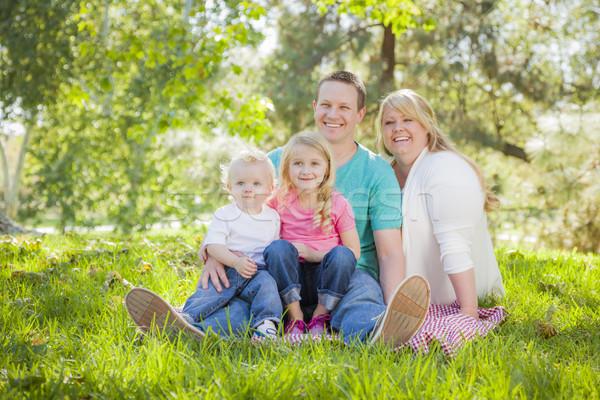 молодые привлекательный Семейный портрет парка человека Сток-фото © feverpitch