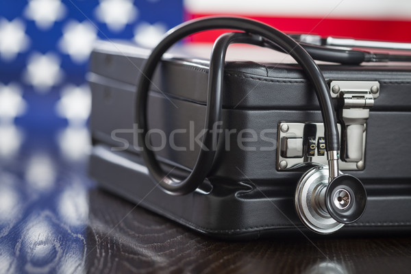 Briefcase and Stethoscope Resting on Table with American Flag Be Stock photo © feverpitch