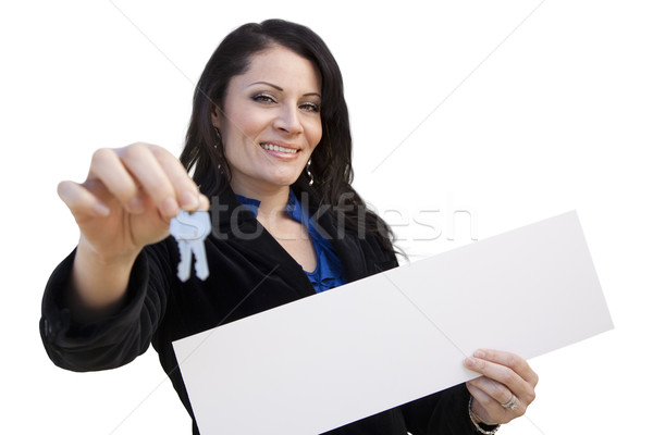 Hispanic Woman Holding Blank Sign and Keys On White Stock photo © feverpitch