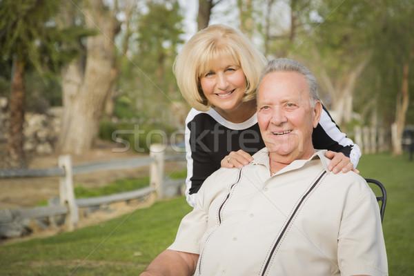Affectionate Senior Couple Portrait At The Park Stock photo © feverpitch