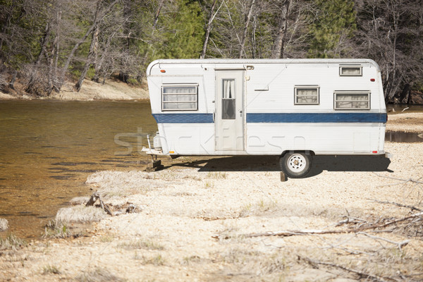Classic Old Camper Trailer Near A River Stock photo © feverpitch