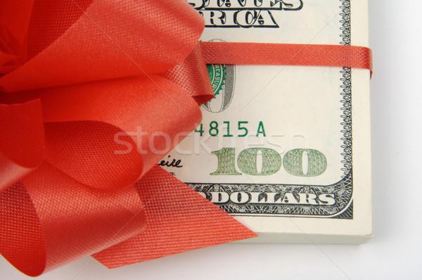 Egy száz dollár bankjegyek vörös szalag pénz zöld Stock fotó © feverpitch