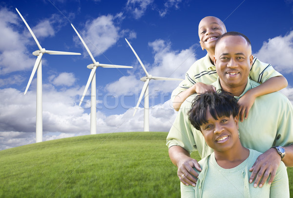 Happy African American Family and Wind Turbine Stock photo © feverpitch