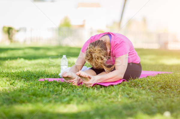 Young Fit Flexible Adult Woman Outdoors on The Grass With Yoga M Stock photo © feverpitch