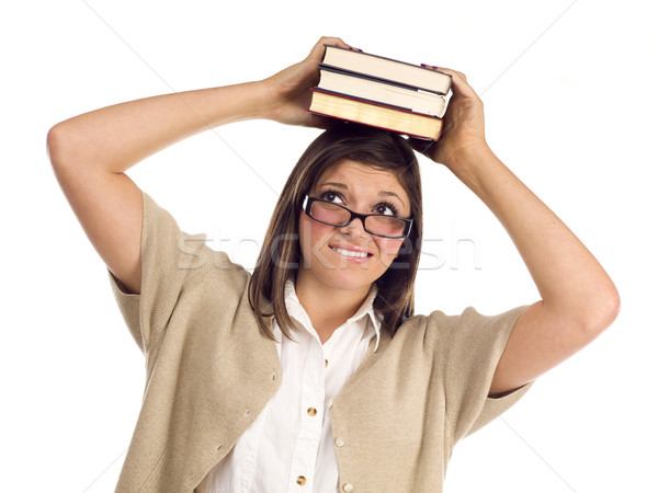 Ethnic Student with Books on Her Head Over White Stock photo © feverpitch